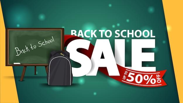 Terug naar school verkoop, groene webbanner met schoolbestuur en schoolrugzak