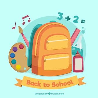 Terug naar schoolontwerp met rugzak en schoolobjecten