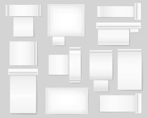 Textiel witte blanco etiketten set. een reeks realistische textieletiketten op grijze achtergrond lege sjablonen voor het plaatsen van instructietekstlogo's