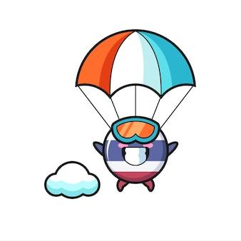 Thailand vlag badge mascotte cartoon is parachutespringen met gelukkig gebaar, schattig stijlontwerp voor t-shirt, sticker, logo-element Premium Vector