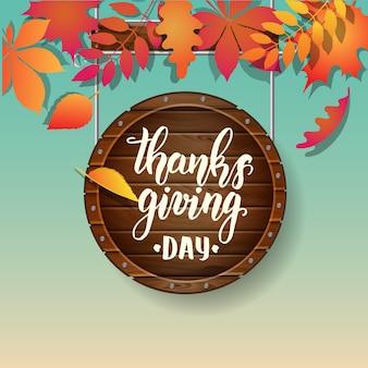 Thanksgiving day belettering kalligrafie zin. herfst achtergrond met bladeren