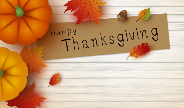 Thanksgivingontwerp van pompoen en esdoornbladeren op wit hout