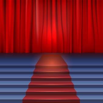 Theaterpodium met rood gordijn en tapijt.