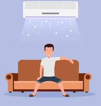 Thuis airconditioning, kamer met koeling, een man op de bank met klimaatbeheersing in de kamer.