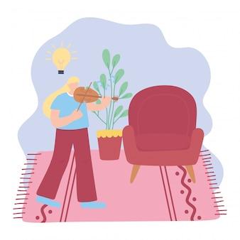 Thuis blijven, meisje met viool in de kamer, zelfisolatie, activiteiten in quarantaine ter illustratie van het coronavirus