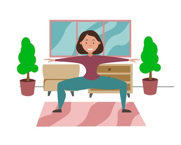 Thuis trainen tijdens quarantaine het meisje doet thuis squats met haar benen wijd gespreid