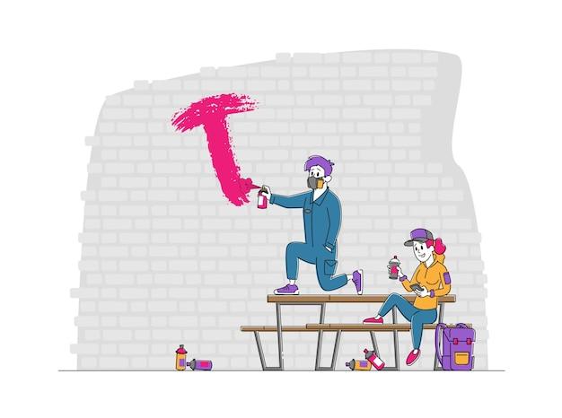 Tieners die graffiti op bakstenen muur schilderen