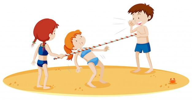 Tieners doen limbo dansen op het strand