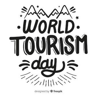 Toerisme dag concept met letters