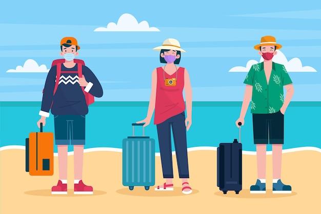 Toeristen dragen gezichtsmaskers op het strand