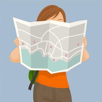 Toeristenmeisje met kaart in de stad
