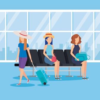 Toeristenmeisjes met koffers in de luchthaven