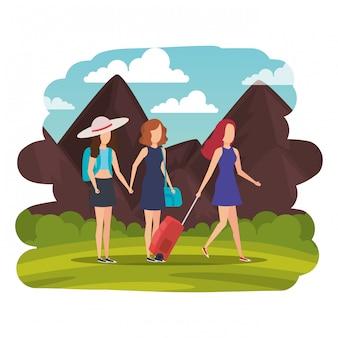 Toeristenmeisjes met koffers op het landschap