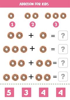 Toevoeging met cartoon donuts. rekenspel voor kinderen.