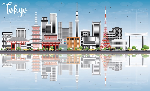 Tokyo skyline met grijs gebouwen, blauwe hemel en reflecties.