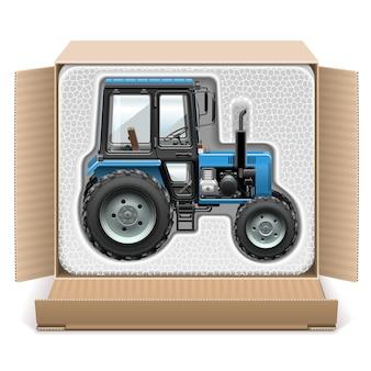 Toy tractor in box geïsoleerd op een witte achtergrond