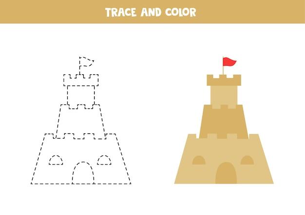 Traceer en kleur cartoon zandkasteel. educatief spel voor kinderen. schrijven en kleuren oefenen.