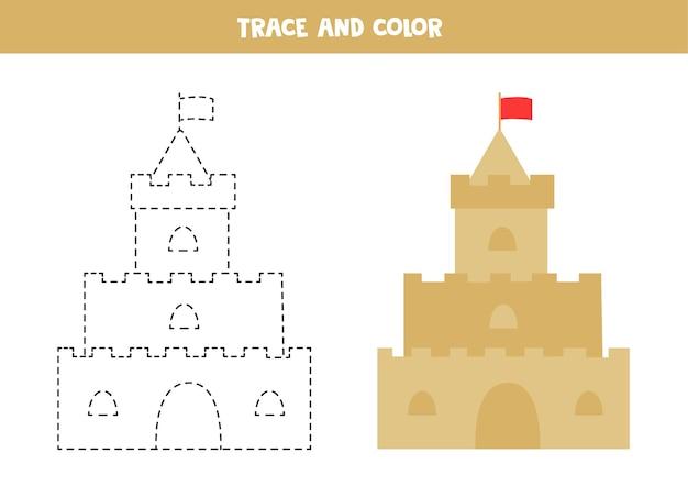 Traceer en kleur cartoon zandkasteel. werkblad voor kinderen.