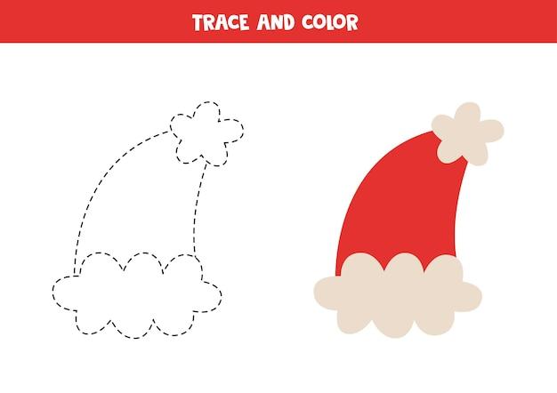 Traceer en kleur schattige kerstmuts. werkblad voor kinderen.