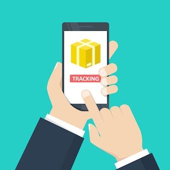 Tracking. smartphone van de handholding met de illustratie van de kartondoos