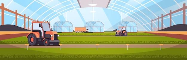 Tractoren werken aan biologische producten industriële plantage groeiende planten slimme landbouw agribusiness