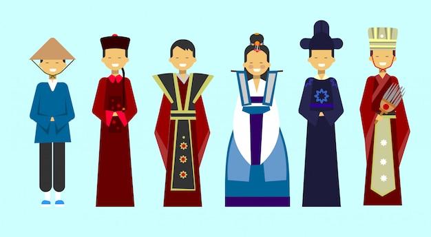 Traditionele aziatische kleding set mensen dragen prachtige nationale kostuums
