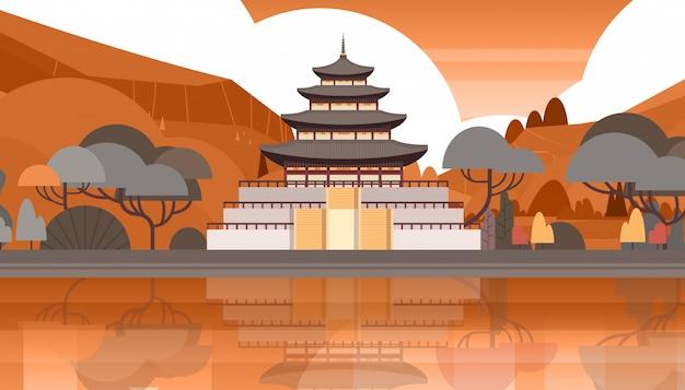 Traditionele korea tempel over bergen silhouet landschap zuid-koreaanse paleis gebouw beroemde bezienswaardigheid view