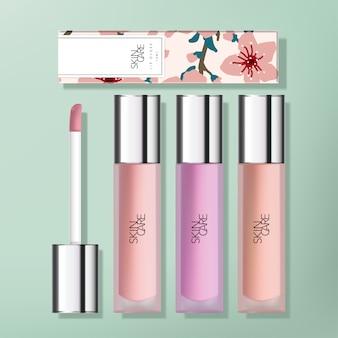 Transparante frosted plastic lipgloss verpakking met glanzende verzilverde applicator dop. sakura bedrukte kartonnen doos.