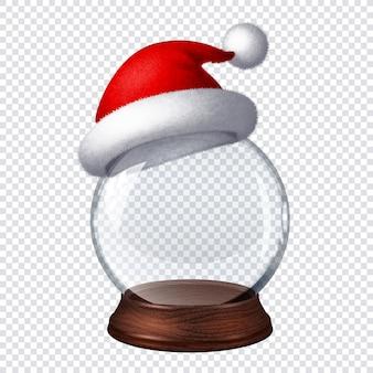 Transparante sneeuwbol met kerstmuts op geruite achtergrond.