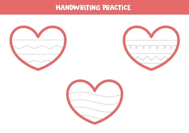 Trek de lijnen in de valentijnsharten over. handschriftoefening voor kinderen.
