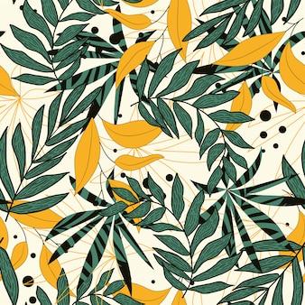 Trend abstract naadloos patroon met kleurrijke tropische bladeren en planten op beige achtergrond