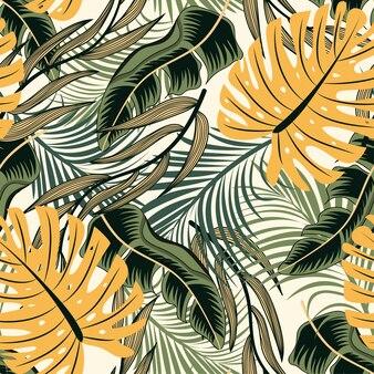 Trend abstract naadloos patroon met kleurrijke tropische bladeren en planten op pastel achtergrond