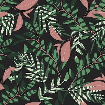 Trend naadloos patroon met tropische bladeren en planten op een donkere kleur