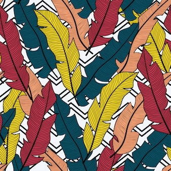 Trend naadloos patroon met tropische rode en gele bladeren en planten