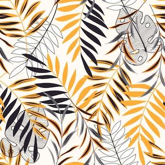Trend vector tropisch naadloos patroon met gele en zwarte bladeren