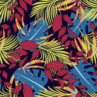 Trending abstract naadloos patroon met kleurrijke tropische bladeren en planten op paarse achtergrond