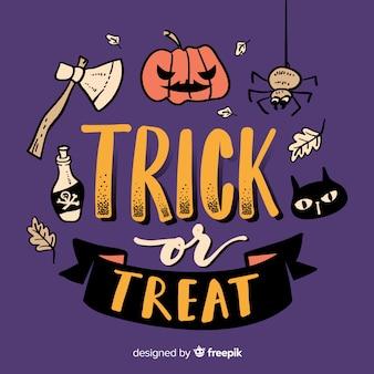 Trick or treat belettering met gesneden pompoen