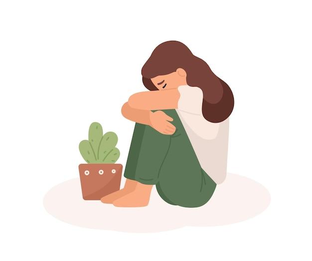 Triest jong meisje platte vectorillustratie. slecht humeur, melancholie, verdriet, negatieve emoties concept. huilende vrouw knuffelen haar benen en bloempot stripfiguur geïsoleerd op een witte achtergrond.