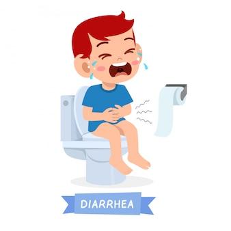 Triest kind jongen huilen op het toilet