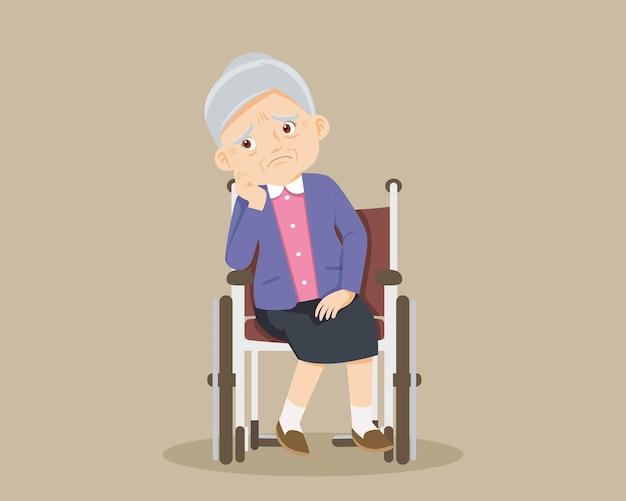 Triest oudere vrouw verveeld, triest senior vrouw zittend in een rolstoel