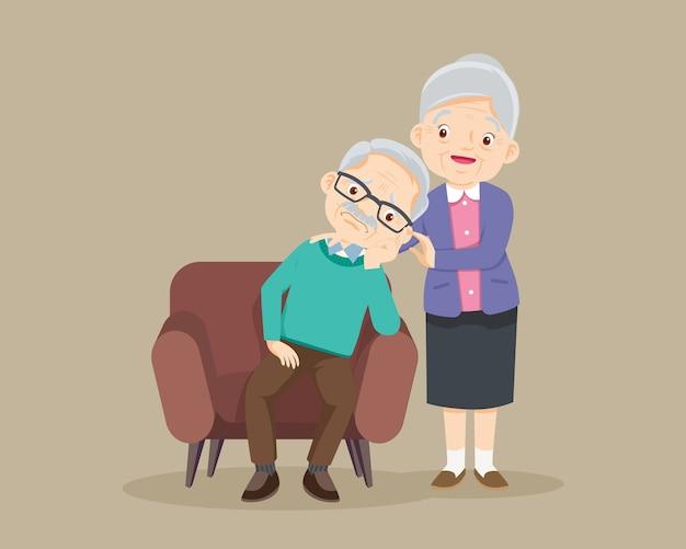 Trieste oudere man verveeld, triest senior man zit en senior vrouw troost haar boos, grootmoeder troostende grootvader