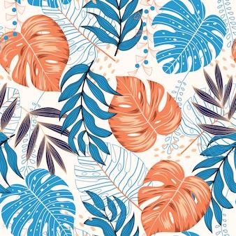 Tropisch naadloos patroon met blauwe en bruine bladeren