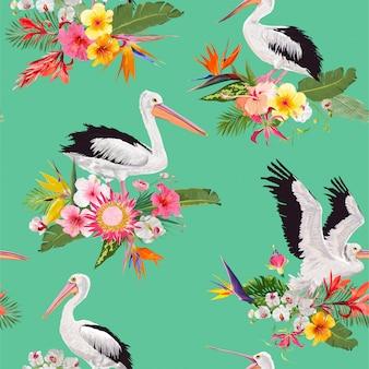 Tropisch naadloos patroon met pelikanen en bloemen