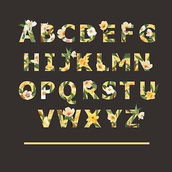 Tropische alfabet serif lettertype geel typografische zomer met planten gebladerte