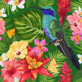 Tropische naadloze patroon met bloemen en zoemende vogels