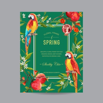 Tropische papegaaivogels, granaatappels en bloemen kleurrijk frame