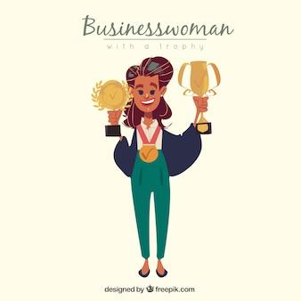 Trotse zakenvrouw met trofeeën