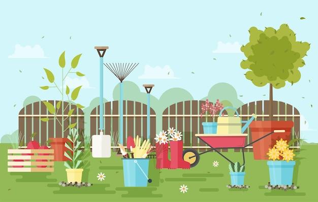 Tuin- en landbouwapparatuur en gereedschappen tegen houten schutting en tuinplanten