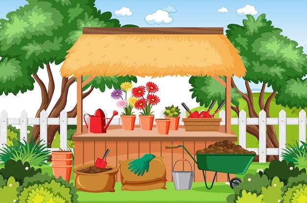 Tuin met bloemen en veel gereedschap