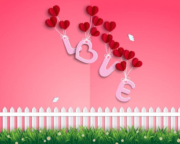 Tuin van liefde met rode ballonnen zwevend in de lucht